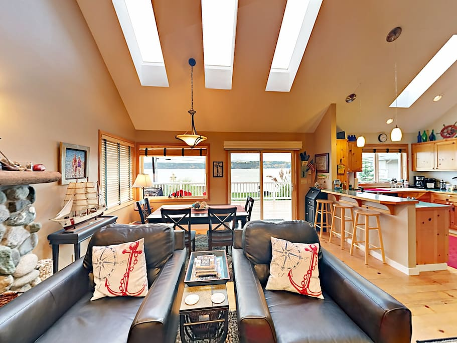 The 2-story home features vaulted ceilings, epic beach views, and lots of natural light throughout.