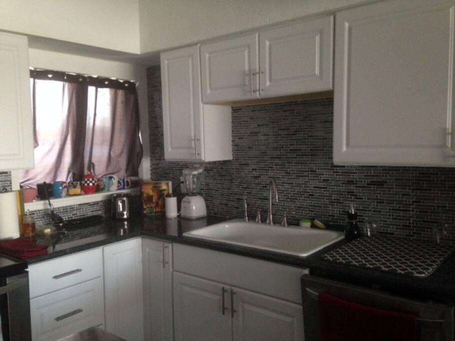 Full kitchen include fridge/freezer, dishwasher, microwave, oven, Keurig Coffee machine with pods, wine fridge, toaster, crock pot.