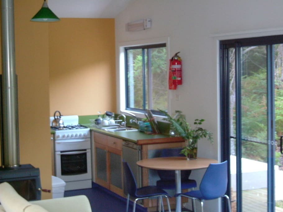 Self contained kitchen with gas range, fridge, pots, pans, crockery, cutlery etc.