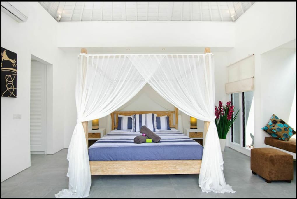 Large beds with mosquito nets