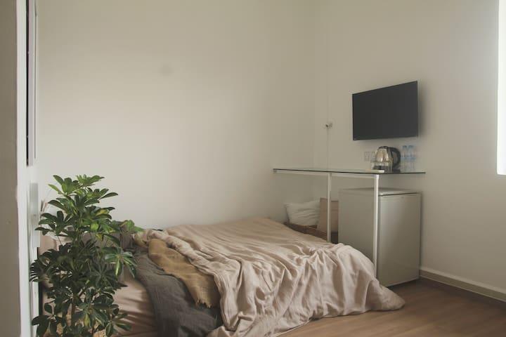 Bed facing TV