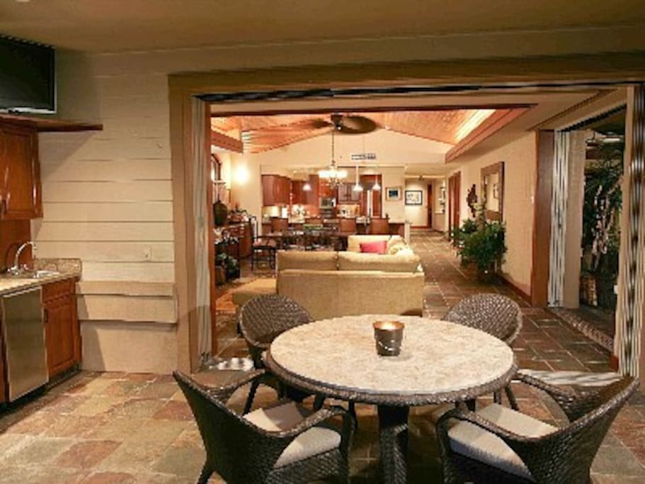 Enjoy a covered lanai with kitchen, grill and informal dining area near the pool