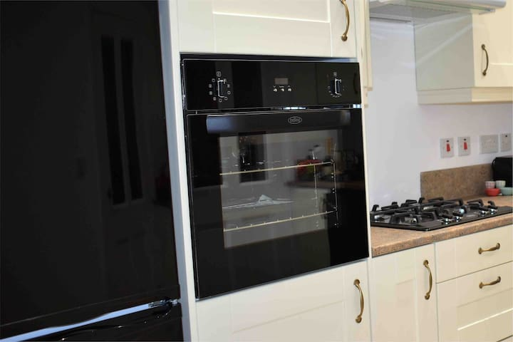 Fully-fitted and equipped kitchen- gas hob, oven, large fridge and freezer
