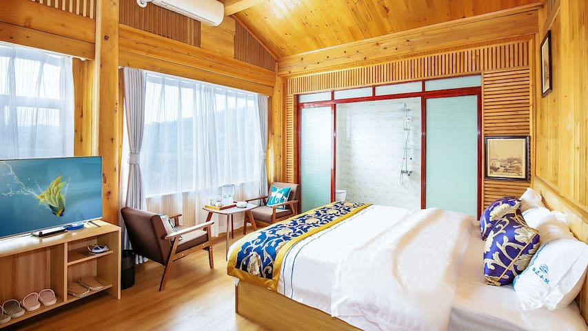 栖迟小院客栈(木式风格和美观景大床房)