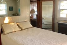 Master Bedroom with queen size bed and adjoining full bathroom
