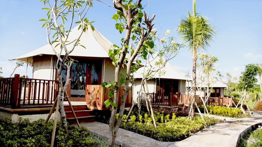 This beach glamping resort and dive center in Bali uses a combination of luxury, top-quality, African safari tents that allow you to be closer to nature while still offering all of the modern comforts of home