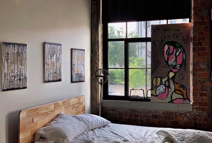 Artists loft in OTR with rooftop view of city.