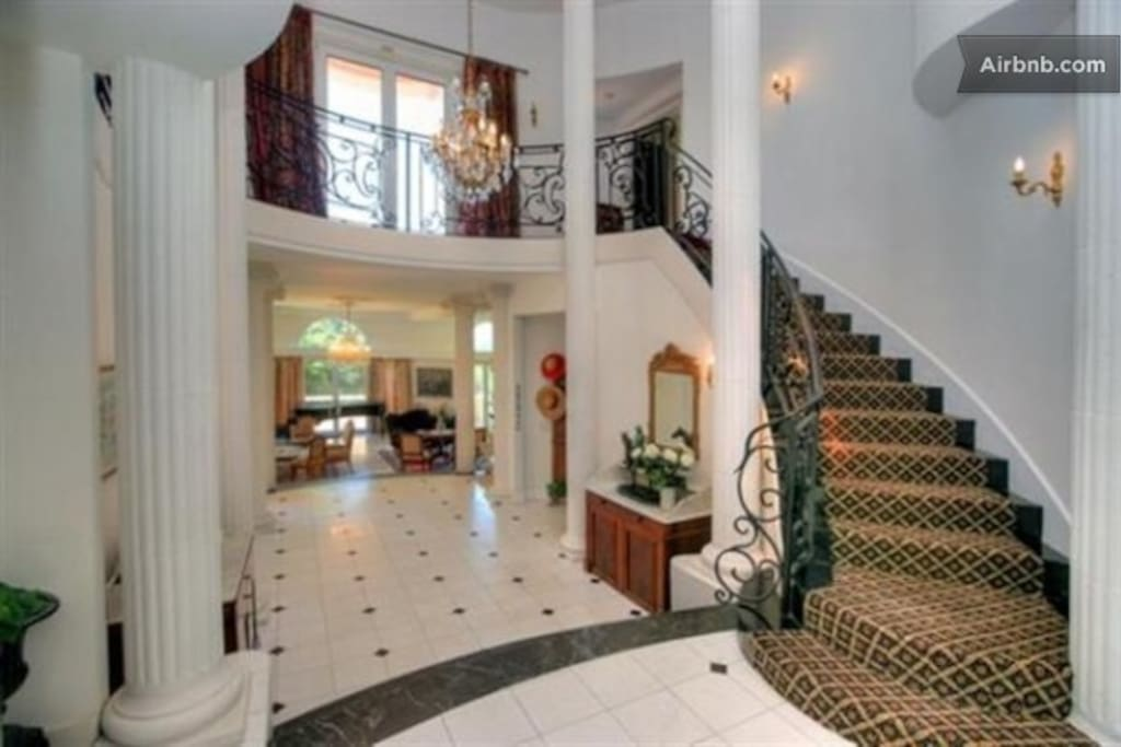Sprial Stairway leading from entry hall to upper level.