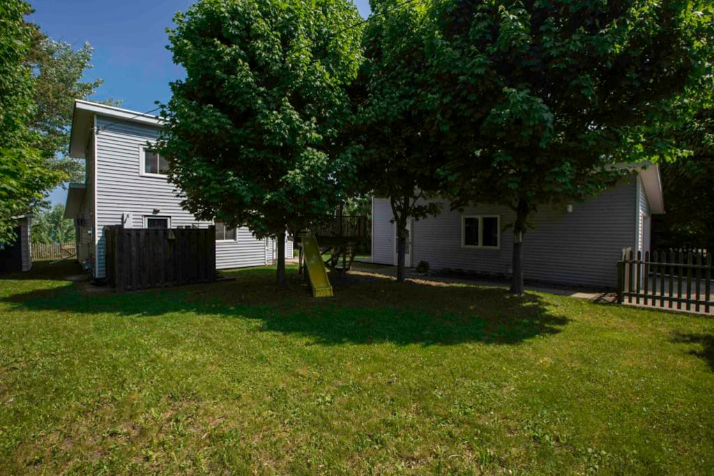 Private fenced in front yard with complete tree coverage for privacy