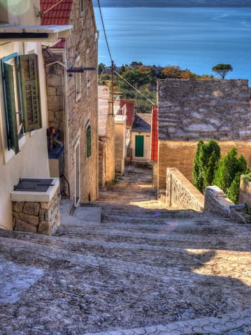 ....and another scene, that will also welcome you, is the view of a beautiful small old village in quiet and beautiful part Brela, with white stone houses and a beautiful rock stairs that the local population calls - Kala. (:     white stone houses