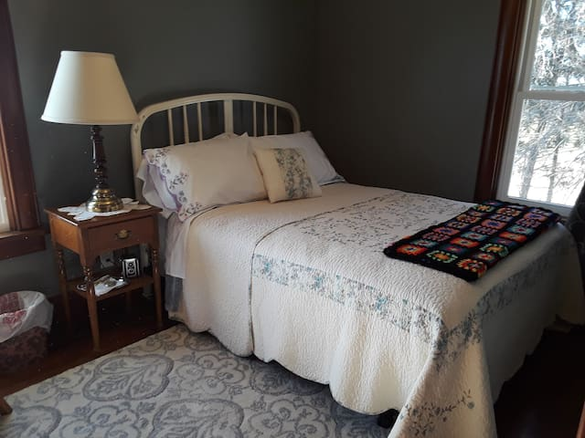 Grey room with full-size bed
