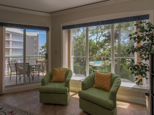 The Living area in 301 Windsor Place offers views of the Atlantic Ocean and complex pool