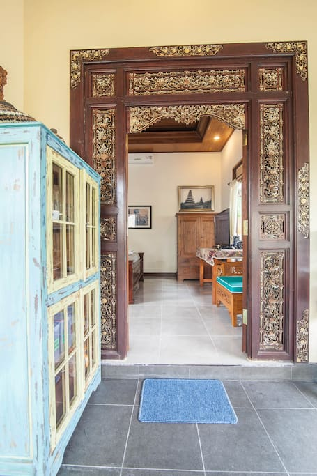 Beautiful Hand Carved Balinese Doors bring you into the Bedroom