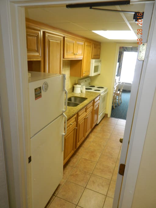 Galley Style Kitchen with beautiful granite counter tops
