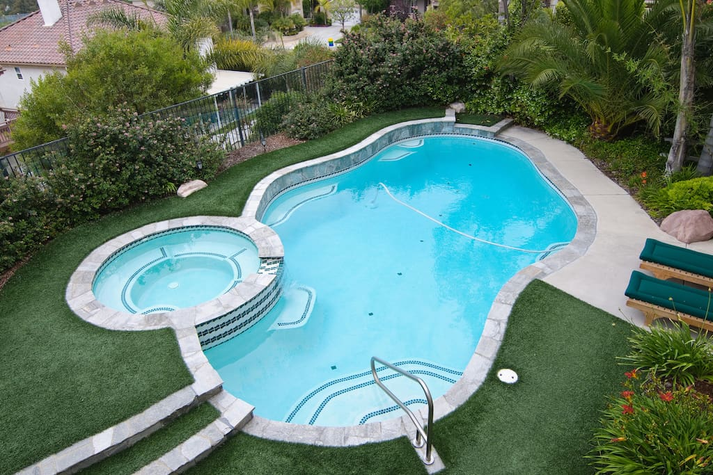 Solar heated pool and heated jacuzzi with recliners