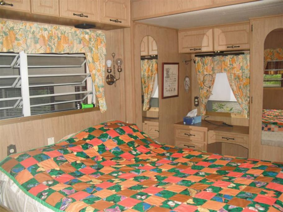 2nd bedroom with bathroom. Both beds have home-made quilts