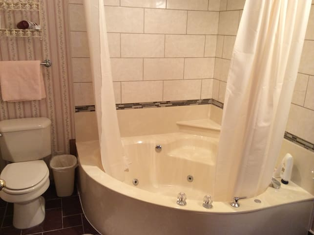Large whirlpool tub and shower in the Rose suite.