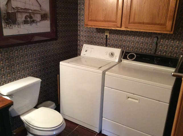 Laundry room with half bath.