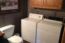 Laundry room with half bath.