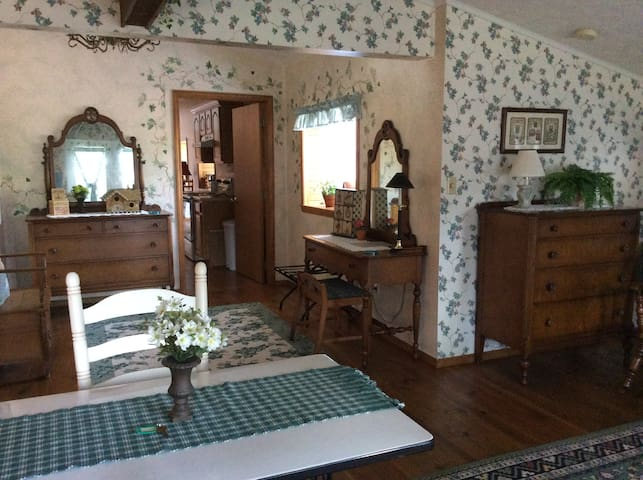 This shows part of the Ivy suite with an access door to the kitchen and living room in the back of the photo.