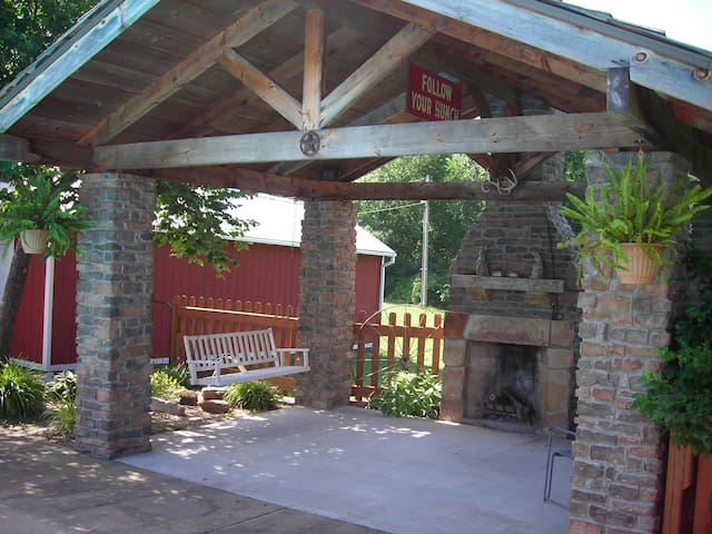 Sit on the porch swing and enjoy the outdoor fireplace under the cabana in the terrace garden.