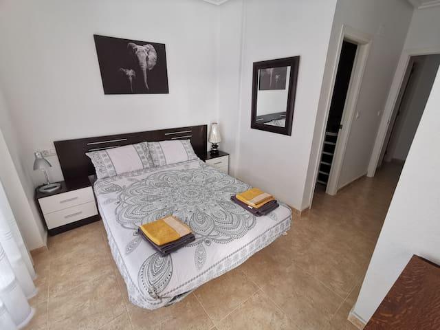 Master Bedroom with en suite bathroom and balcony access