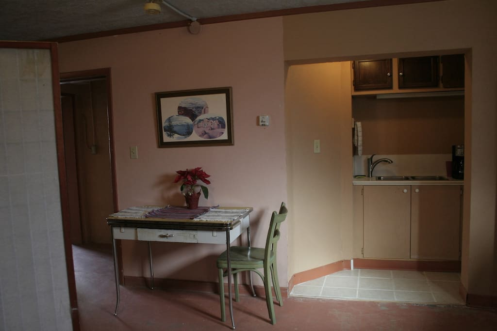 The dining area with a view of the entrance and the galley kitchen.