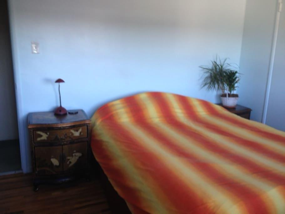 Bedroom with queen size bed.