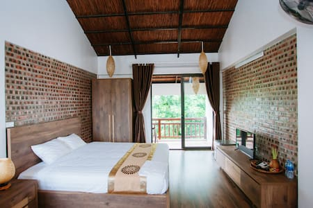 The spacious deluxe room with a private balcony with mountain view