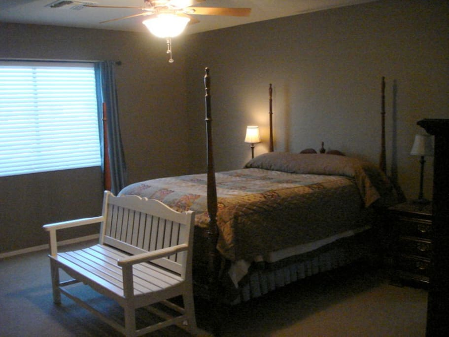 Master bedroom with private bathroom, double sink, shower/tub.