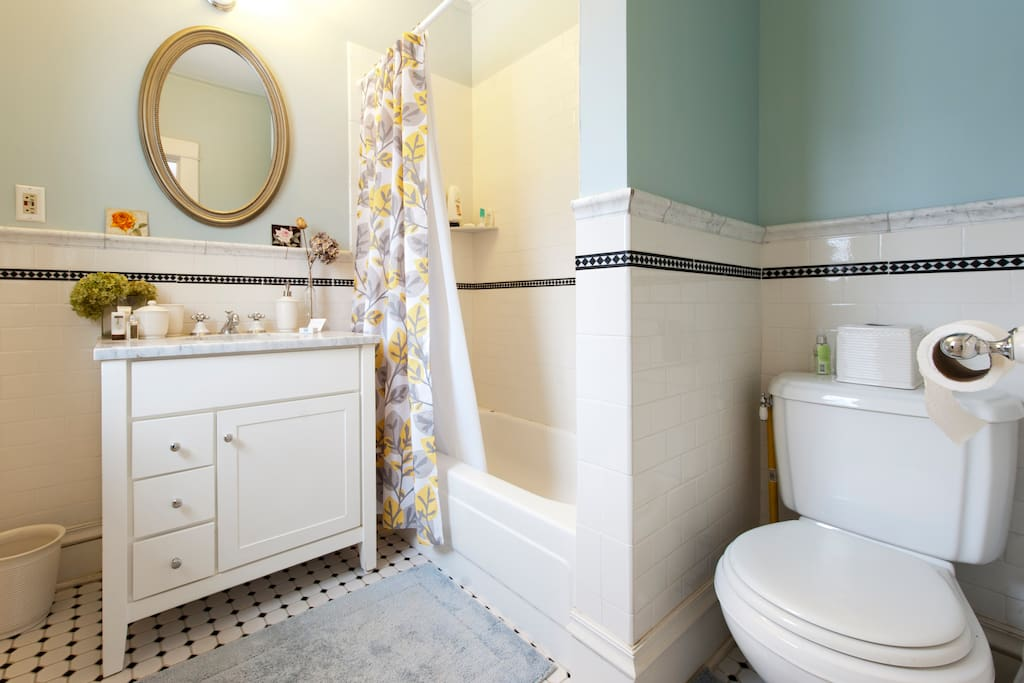 Your en suite bathroom. Shower and bathtub. We provide shampoo, conditioner, soaps and lotion, and clean towels!