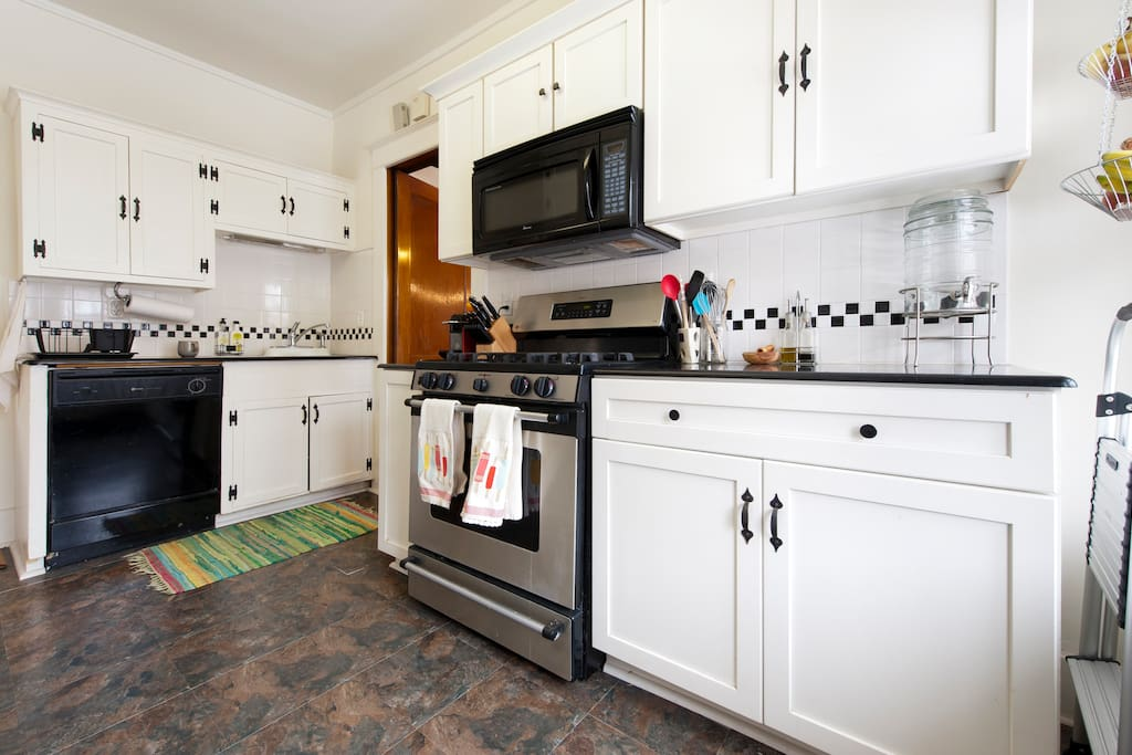 Full galley-style kitchen with everything you need to make delicious meals.