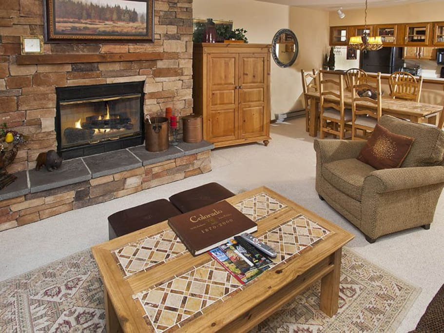 Living room with real fireplace.