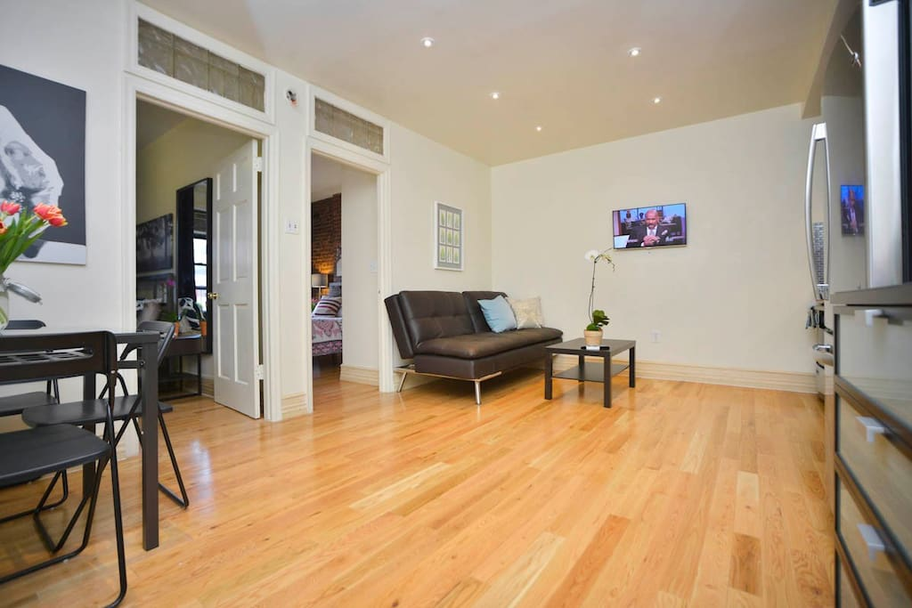 Spacious living space featuring hardwood floors