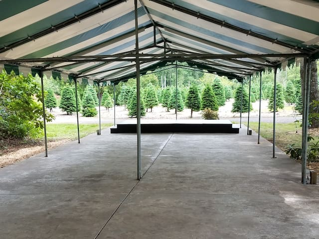 80X20' Tent and stage, picnic tables provided.