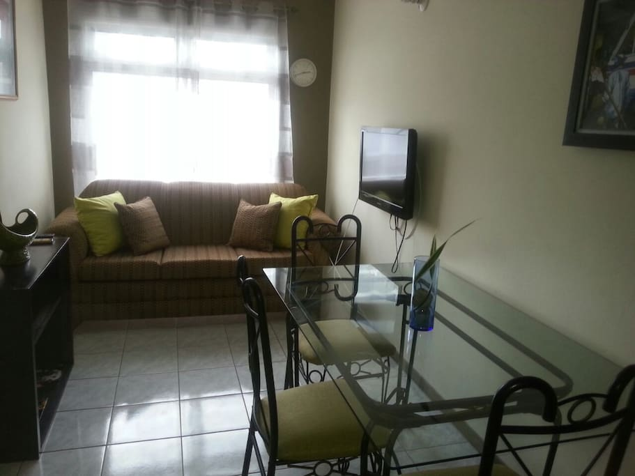 Intimate yet, spacious  living / dinning area  great lighting with flatscreen tv  readily available for those who like to eat and play