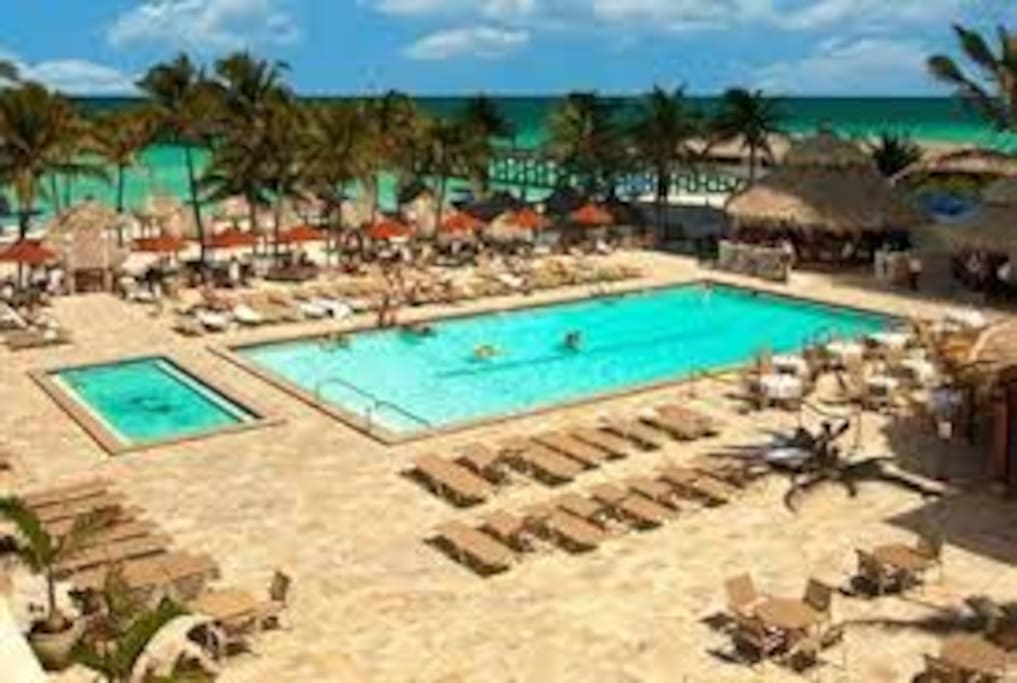 Beautiful backside of the resort with 2 pools, private beachside, fishing pier and restaurant.