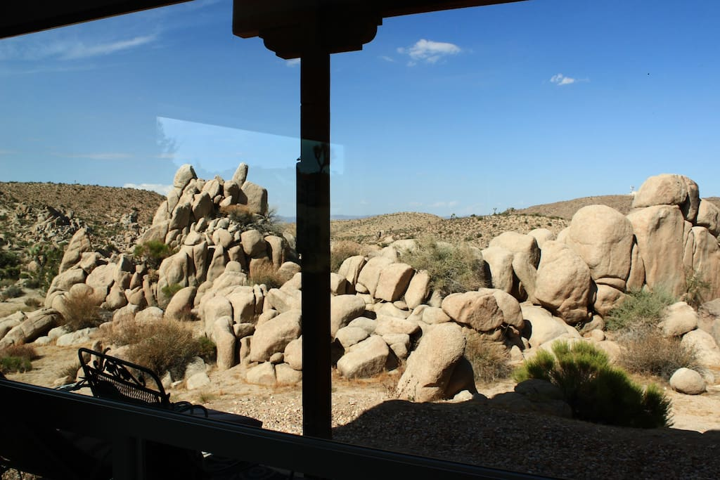 View from the living room. Boulders and hiking trails