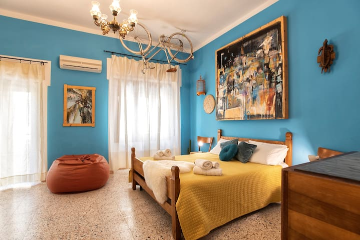 Private room with balcony aircoditioning,private bathroom, wifi and tv.