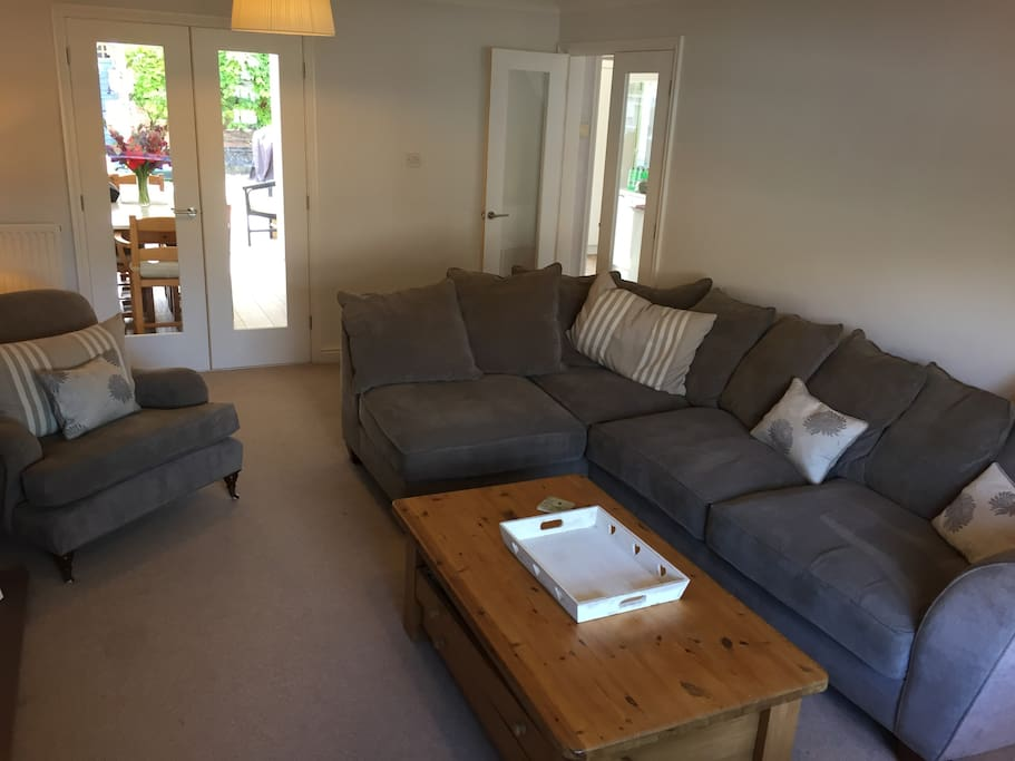 sitting room with 7 seater sofa, chair and poof