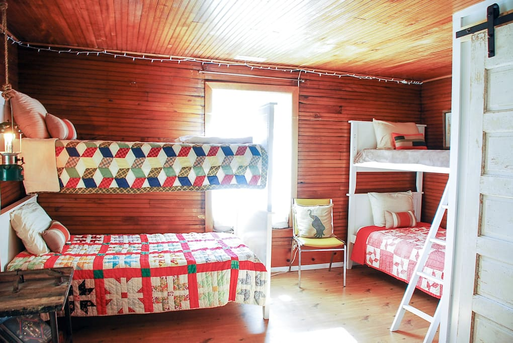 Bunk Room outfitted with 4 single beds and Private Bathroom