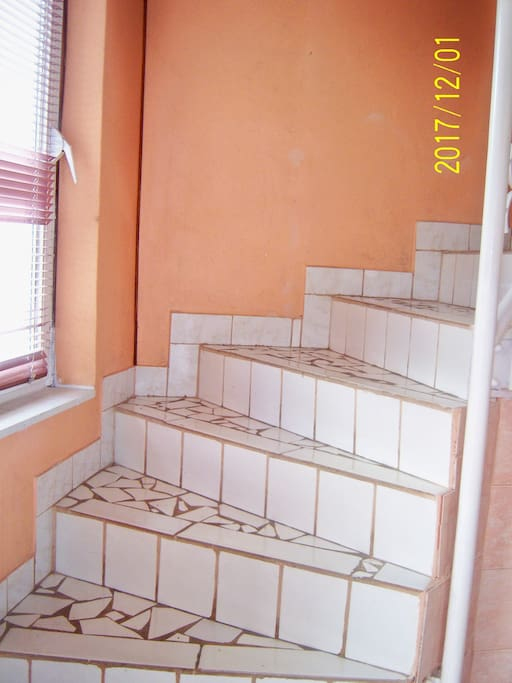 Stairs to the first floor flat