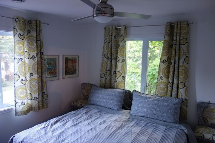 Second Bedroom. King size bed, ceiling fan, silk duvet and good linen. All good excuses to stay in bed and read all day.