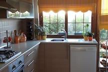 Open plan kitchen with full size cooker /hob,2 large fridge/freezer,dishwasher, toaster,kettle etc...