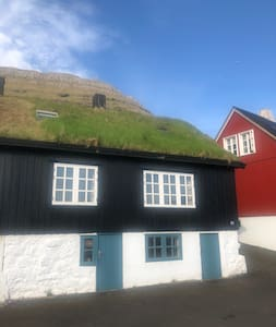 Small fisherman house by the harbour in Norðagøta