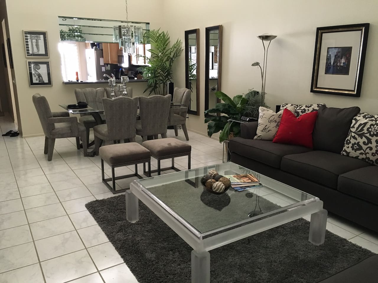 Living Room / Dining Area - Sofa opens to a queen size bed - flat screen, bluetooth and sound bar, plus a wet bar to enjoy your stay