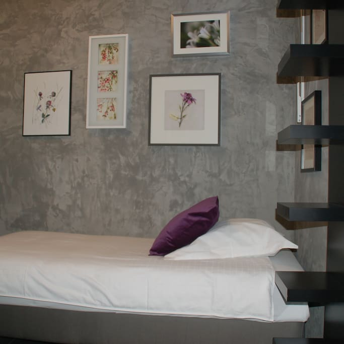 2 comfortable single beds with a large cupboard. The beds are made when you arrive! And remember - there is a sofabed for that 3d person that would like to join you.
