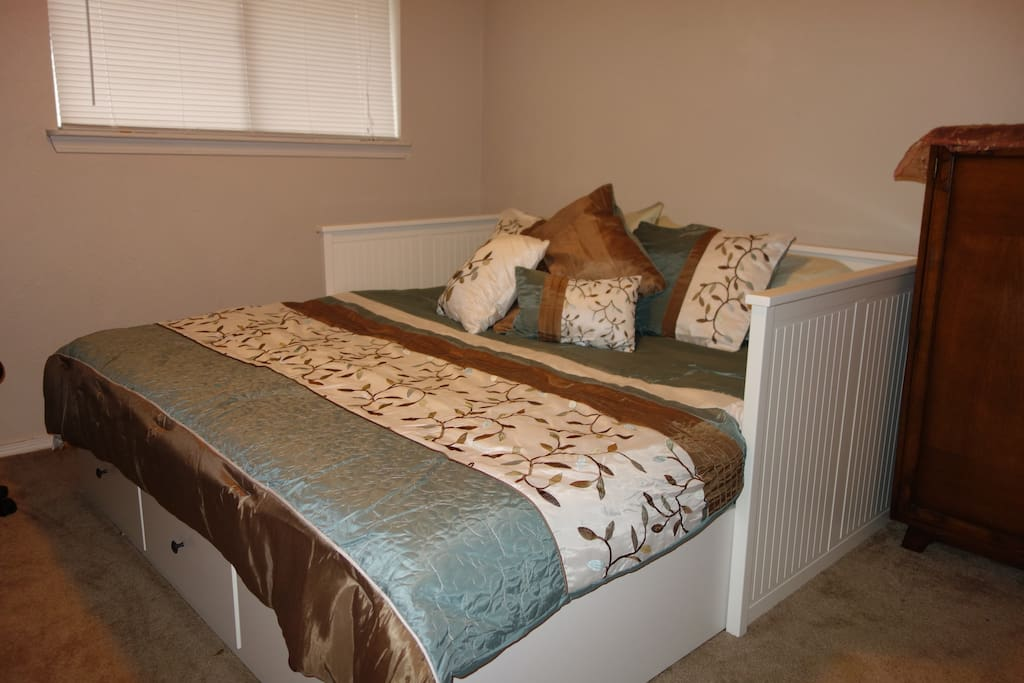 The daybed easily converts into a comfortable king size bed. Both mattresses are slat supported spring mattresses. It is not a pull out sofa or a trundle.