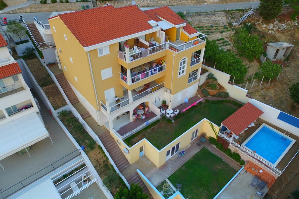 Bird's eye view of the house and communal pool