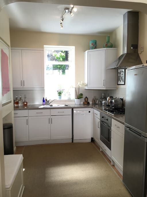 Kitchen shared use, electric oven, gas hob, fridge freezer, microwave, kettle, toaster, dishwasher and view out to back garden. Seats available to sit outside and inside.